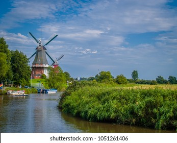 Windmill and Canal near Greetsiel, Germany