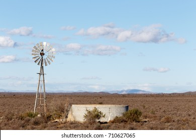 Windmill with a dam in the field of the Central Karoo District.