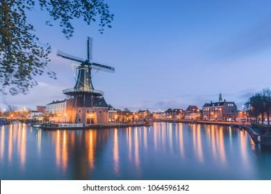 Windmill De Adriaan reflected in river Spaarne Haarlem North Holland The Netherlands