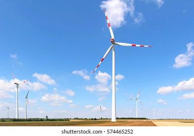 Windmill energy farm on large land field