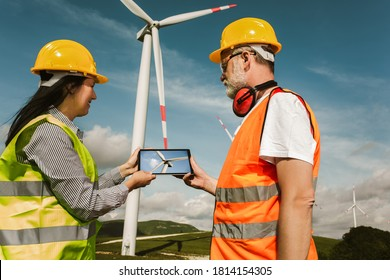 Windmill engineers inspection and progress check wind turbine