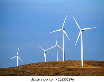 A Windmill Farm on a Mountain at Dusk