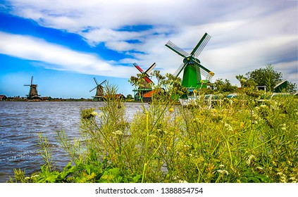 Windmill farm river in Holland. Windmill farmland scene. Windmill river water landscape. Windmill farm river water view