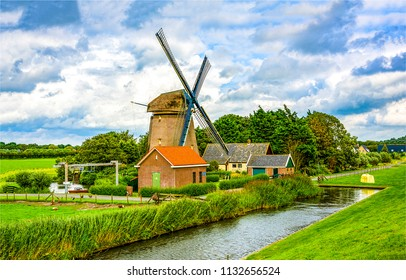Windmill farm river landscape. Windmill dutch farm scene. Netherlands windmill farm view