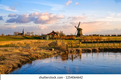Windmill farm river landscape. Windmill farm scene. Village windmill farm river. Windmill farm river view