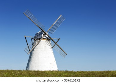Windmill as farm's decoration of the countryside