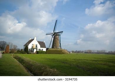 Windmill in field