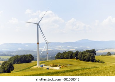 Windmill in the field creating eko energy from wind