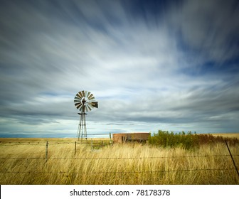 windmill in field with motion in the clouds