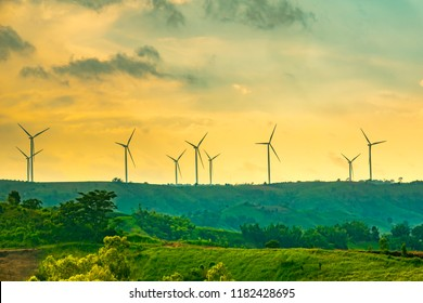 Windmill field technology concept, Windmill or wind turbine on hills of sunset on khao kho mountain in Thailand, New alternative in novation for renewable power of electric energy in beautiful view