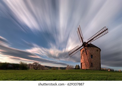 Windmill and flying clouds