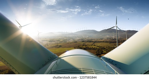 Windmill generator top wiev on the beautiful background. Sunset nature
