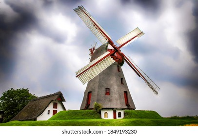 Windmill in gloomy day. Wind mill. WIndmill farm scene. Windmill