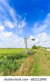 Windmill keeping level drainage ditches in Dutch polder landscape Willeskop, Oudewater, in the province of Zuid Holland the Netherlands