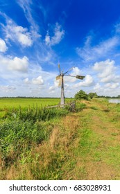 Windmill keeping level drainage ditches in Dutch polder landscape Willeskop, Oudewater, in the province of Utrecht the Netherlands