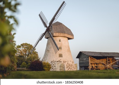 Āraiši windmill in morning light. Traditional mill with large sails at farmstead with moody atmosphere.