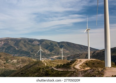 Windmill in mountains on sly background