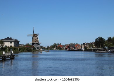 """Windmill named """"De Salamander"""" along river Vliet in Leidschendam, which saws timber on the Wind"""
