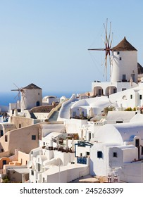 Windmill in Oia, Santorini. Oia is a village in the north west edge of the Santorini island with white houses.