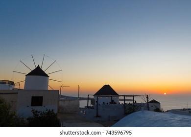 Windmill in Oia at sunset, Santorini, Greece
