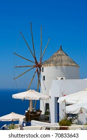 Windmill in Oia village on island of Santorini, Greece