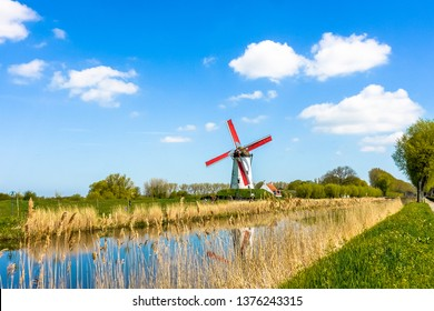 Windmill on the banks of the Damme Canal near Bruges, West Flanders, Belgium