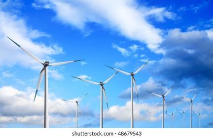 Windmill on cloudy sky