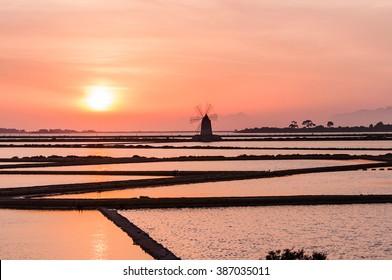 Windmill on expanse of salt