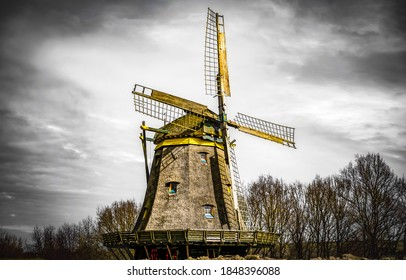 Windmill on a gloomy autumn day. Windmill. Windmill landrmark. Windmill farm scene