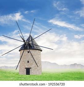 windmill on a meadow under a blue sky