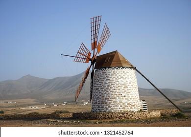 Windmill on the plain of Fuerteventura island, Spain