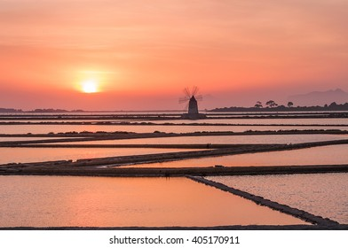 Windmill on the salt flats in Sicily at sunset