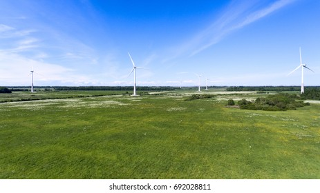 Windmill park with turbines for electricity generation. Aerial view
