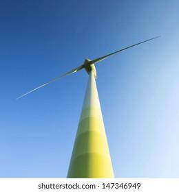 windmill Pinwheel wind turbine wind farm forwards blue skies