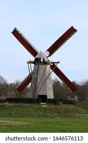 windmill with red blades in Bokrijk, Genk, Belgium