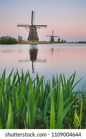 Windmill reflected in the canal Kinderdijk Rotterdam South Holland Netherland Europe