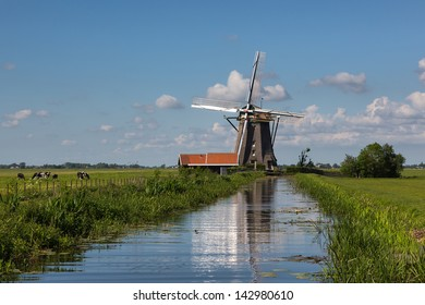 Windmill reflected in a ditch