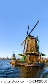 Windmill river farmland scene. Holland windmill river. Windmill river farm view. WIndmill at river
