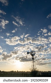 Windmill and rural landscape at sunset in Argentina
