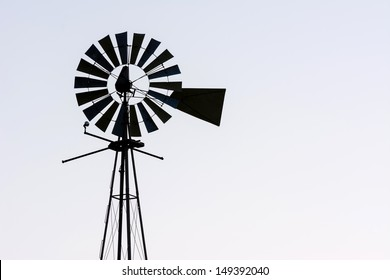 Windmill Silhouette on a Light Grey Background