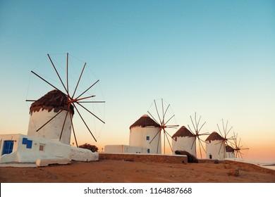 Windmill at sunset as the famous landmark in Mykonos Island, Greece.