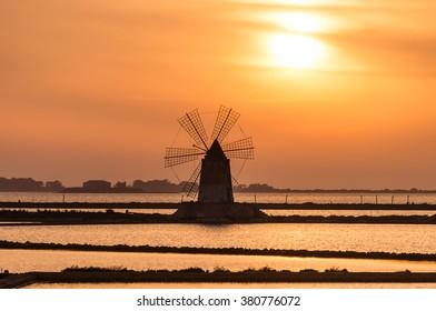 Windmill at sunset on the salt pans