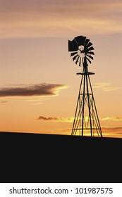 Windmill at sunset, South Dakota
