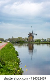 "Windmill ""the Googermolen"" from 1717 with reflection in the water on the Ringvaart canal in Nieuwe Wetering the Netherlands."