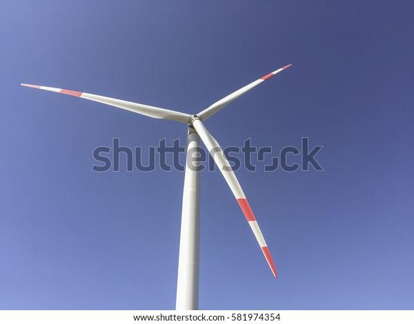 windmill turbine against blue sky
