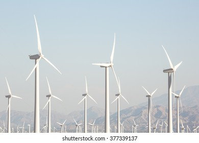 Windmill Turbine Farm Closeup Palm Springs California Clean power generation closeup of Windmills - Turbines near Palm Springs, California. Mountains in the background with an emphasis on the turbines