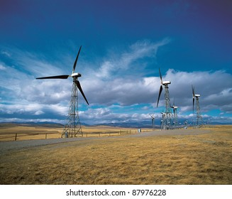 Windmill turbines by Rocky Mountains in Cowley, Alberta, Canada