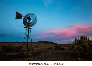 Windmill turning in breeze at sunset