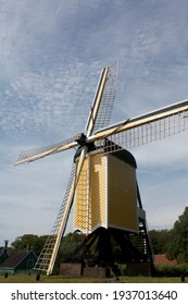 Windmill in a typical Dutch landscape