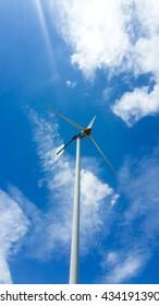 A Windmill under bright blue sky